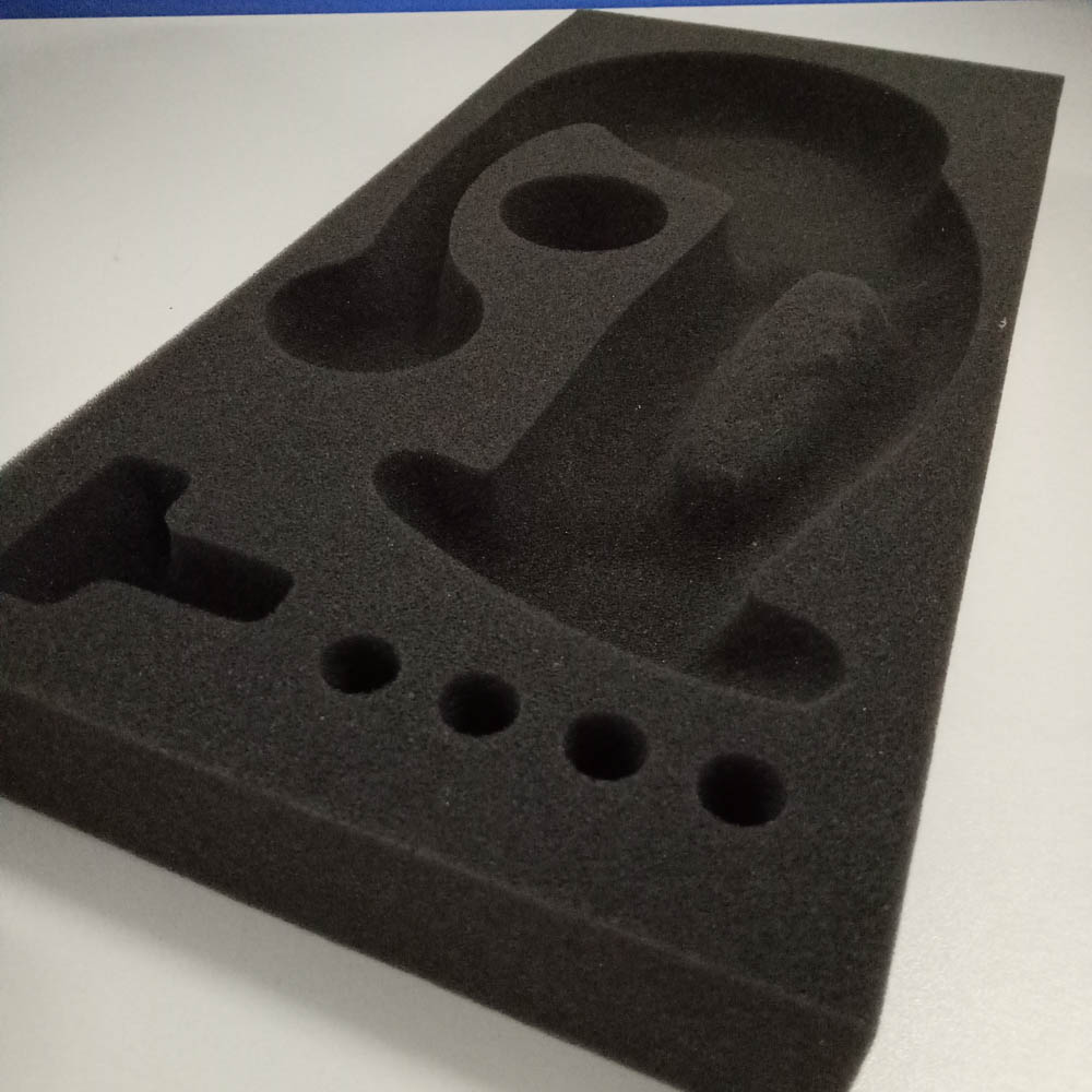 Open cell foam insert for packing